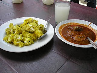 A typical Keralite meal - Tapioca and Karimeen Curry