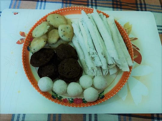 Bihu Snacks- A plate of typical Bihu snacks