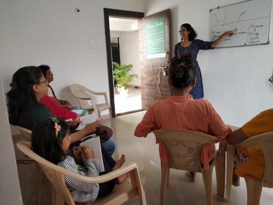Reema conducting a workshop